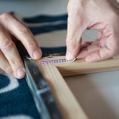 Finitura e montaggio tela fine art su telaio in legno